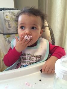 Turning 1 has it's rewards.  Larissa enjoys her first cupcake!